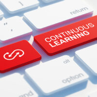 Continuous Learning Icon Concept on the Red Keyboard Button